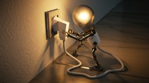 light-bulb-man-plugging-in